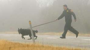 An officer from the Suffolk County Police K-9
