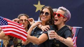 U.S. Women's Soccer team members Alex Morgan (c.)