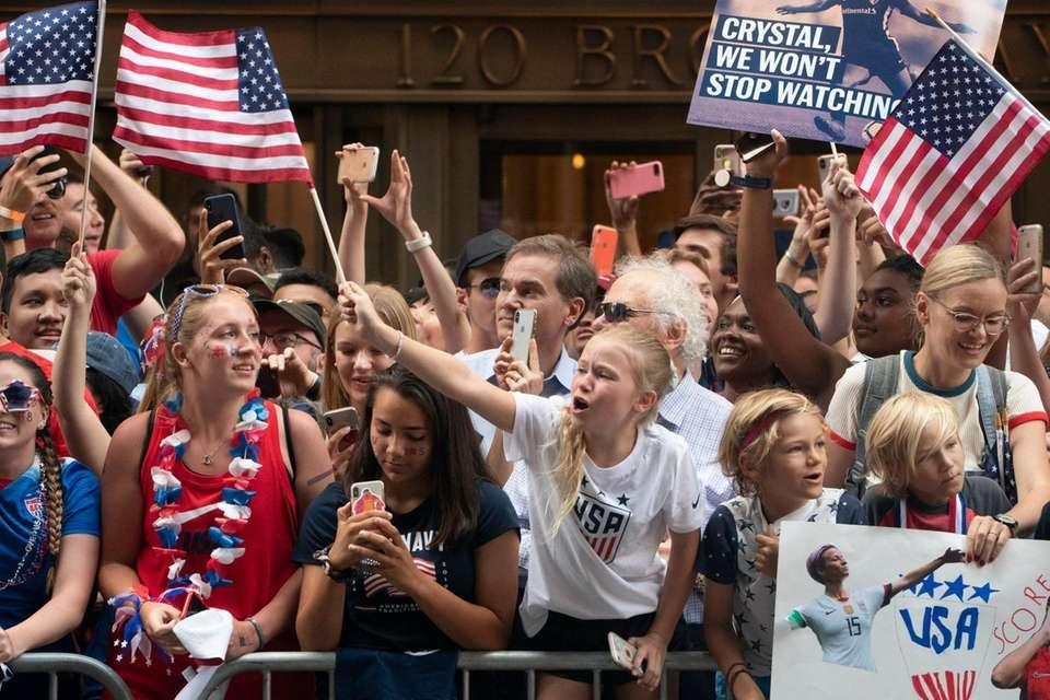 U.S. women's soccer team fans cheer as the