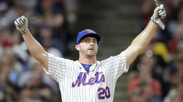 Mets first baseman Pete Alonso reacts after hitting