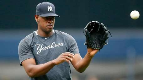 Luis Severino of the Yankees warms up on