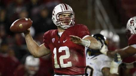 Stanford quarterback Andrew Luck throws against California in