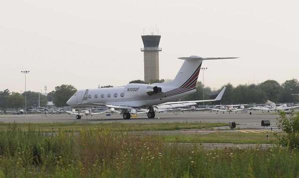 A Gulfstream IV private jet rolls past the