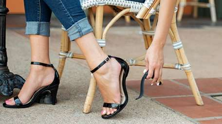 Pashion's black patent leather shoe transitions from a