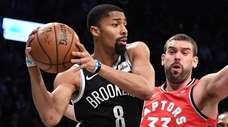 Nets guard Spencer Dinwiddie passes the ball from