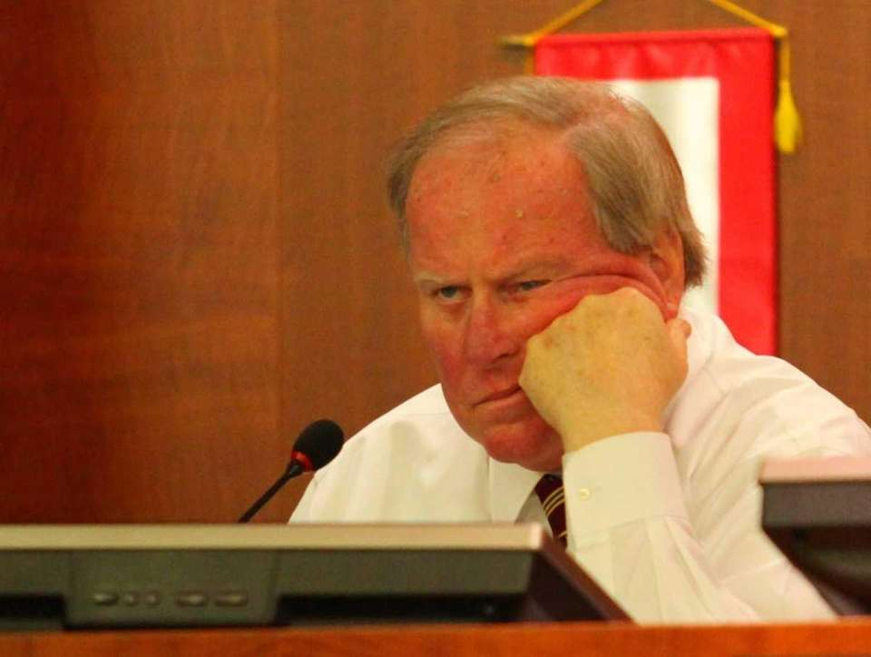 Nassau Legis. Peter Schmitt listens to testimony during