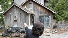Town of Smithtown investigator Karen Sylvester inspects a