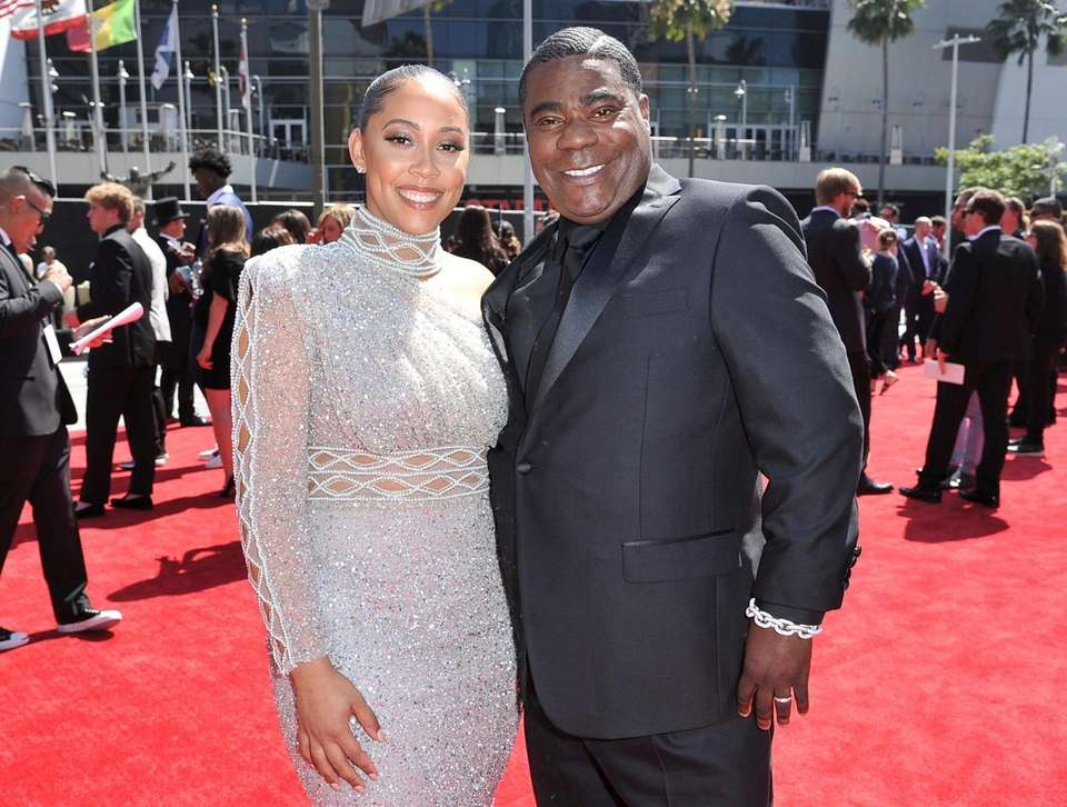 Megan Wollover, left, and Tracy Morgan arrive at