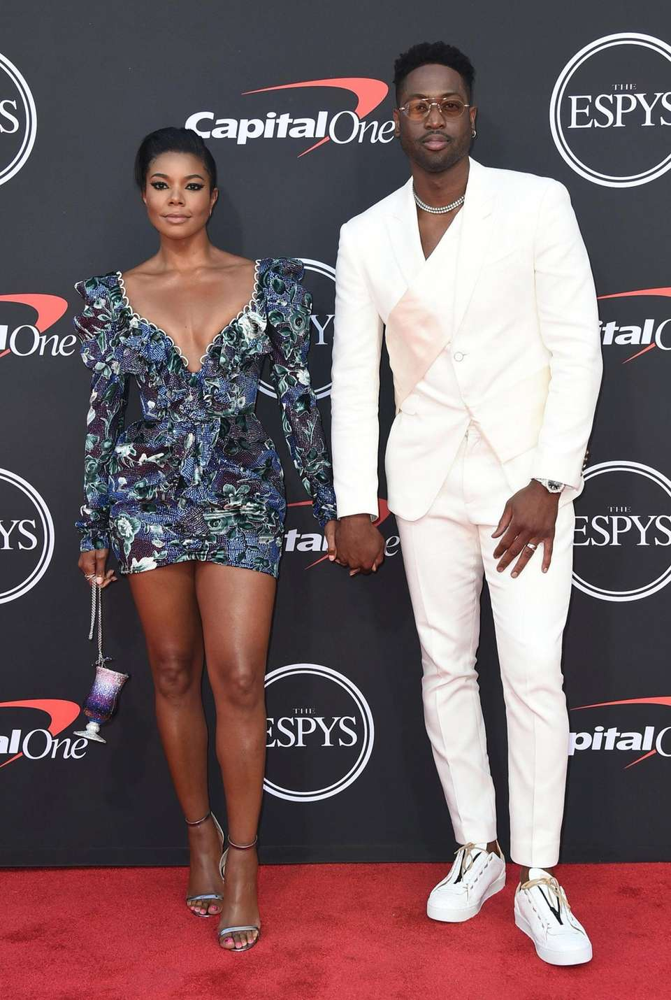 Gabrielle Union, left, and Dwyane Wade arrive at