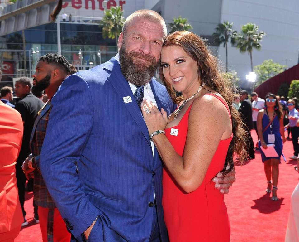 Triple H, left, and Stephanie McMahon, chief brand