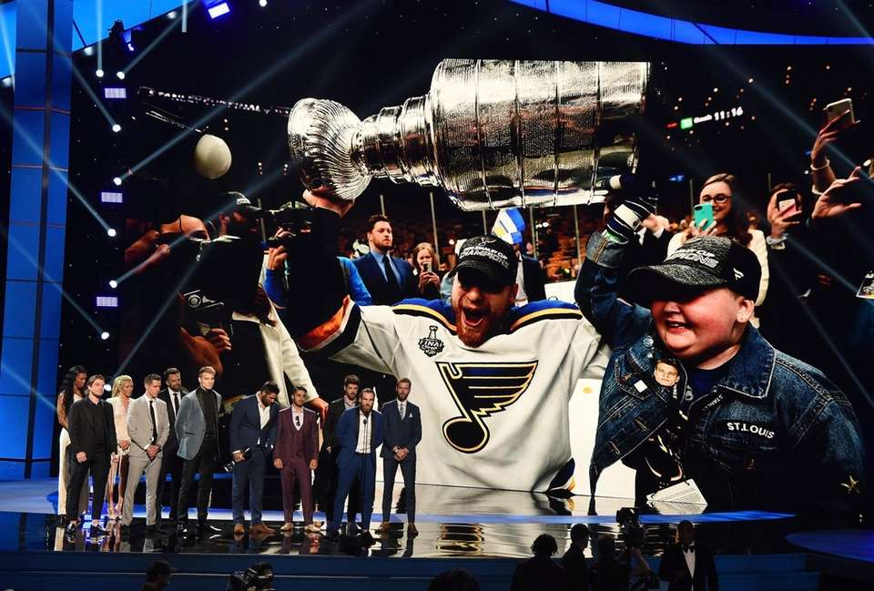 Members of the St. Louis Blues accept the
