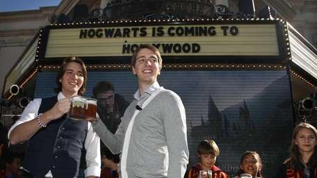 Harry Potter cast members James Phelps (left) and