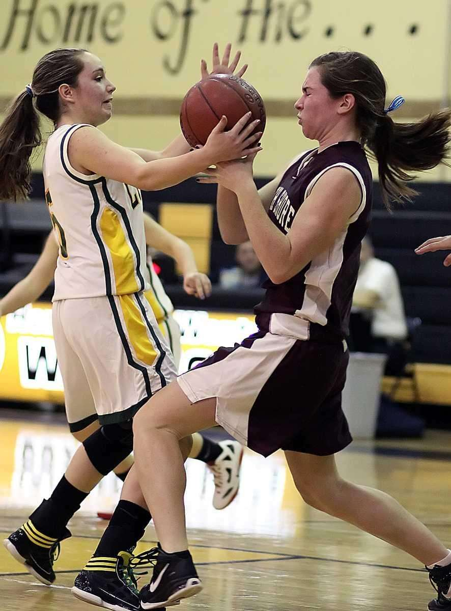 Lynbrook's Shannon Baker tries to avoid a collision