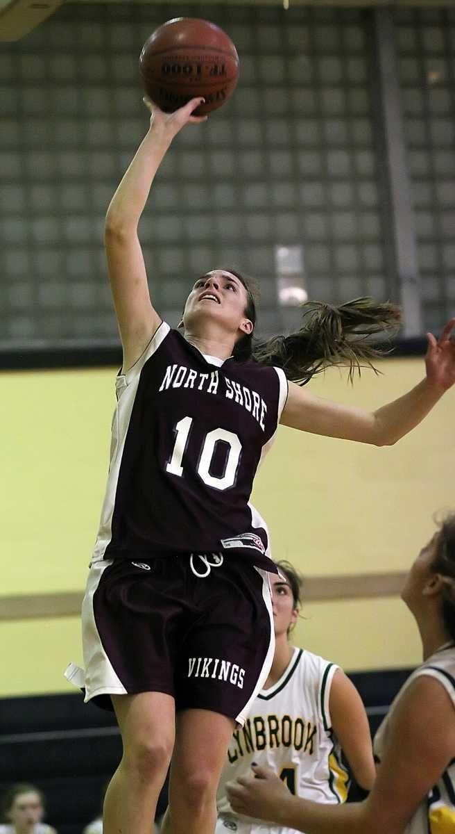 North Shore's Amanda Johansen tries for a basket.