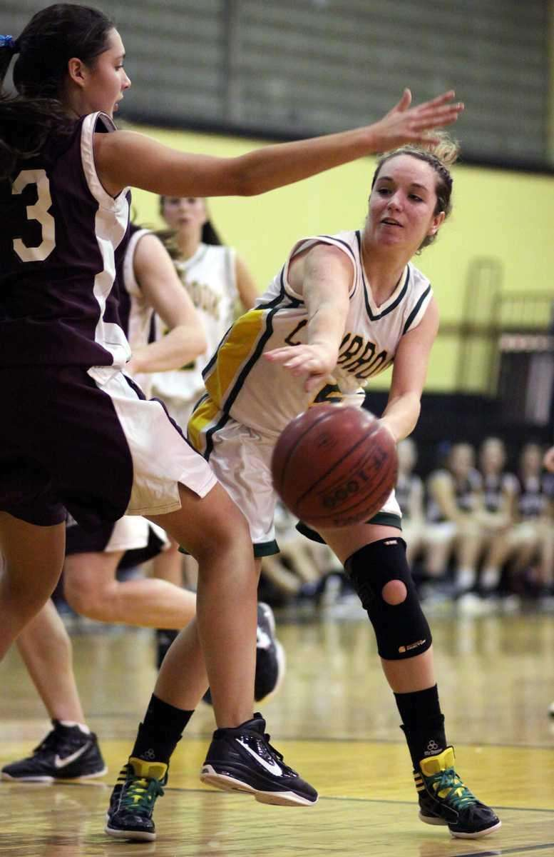 Lynbrook's Shannon Baker gets the pass inside North