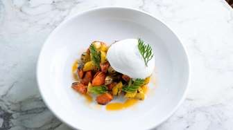 A grilled organic carrot salad with labneh foam,