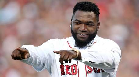 Former Boston Red Sox player David Ortiz reacts