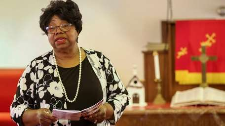The Rev. Jessie Fields leads a weekly prayer