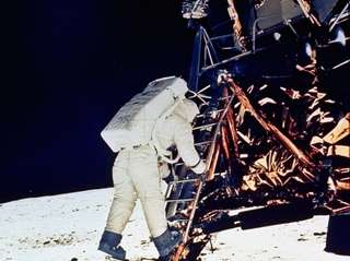 "Astronaut ""Buzz"" Aldrin prepares to walk on the"