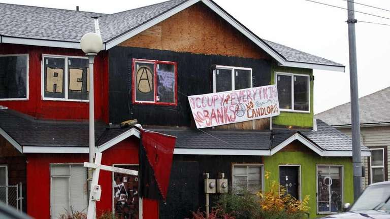A formerly boarded-up duplex that protesters have taken