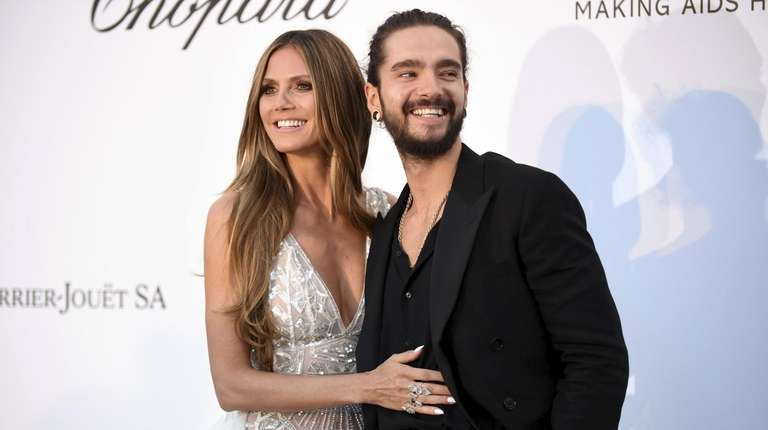 Heidi Klum, left, and Tom Kaulitz attend the