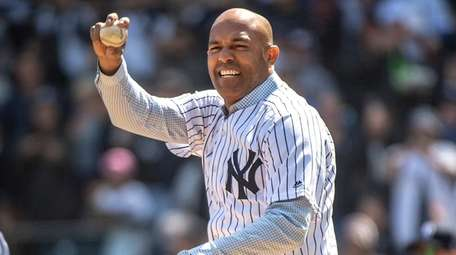 Former Yankees pitcher Mariano Rivera throws out the
