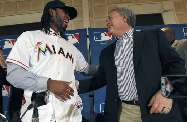 Miami Marlins owner Jeffrey Loria, right, and Jose