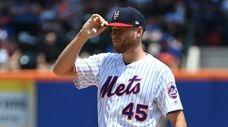 New York Mets starting pitcher Zack Wheeler reacts