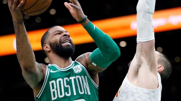 Boston Celtics' Marcus Morris (13) shoots against Atlanta