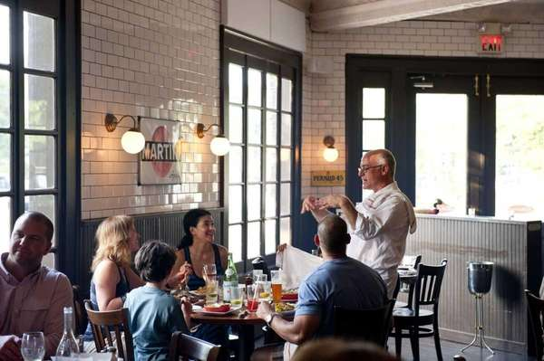 Diners gather at Almond restaurant at 1 Ocean
