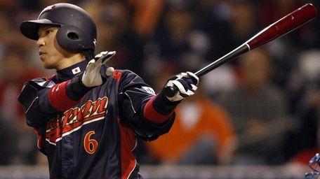 Japan's Hiroyuki Nakajima watches his run producing sacrifice