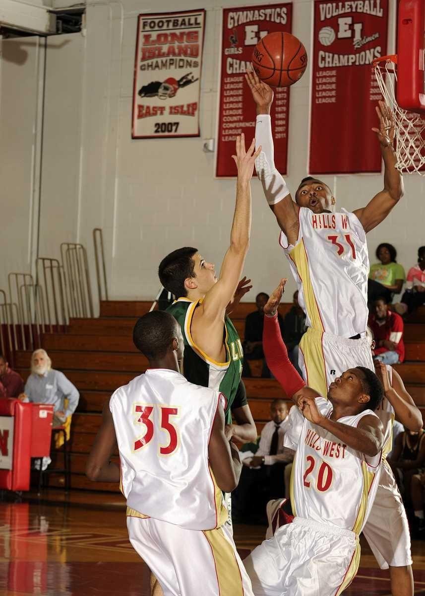 Hills West's Emile Blackman blocks the shot of