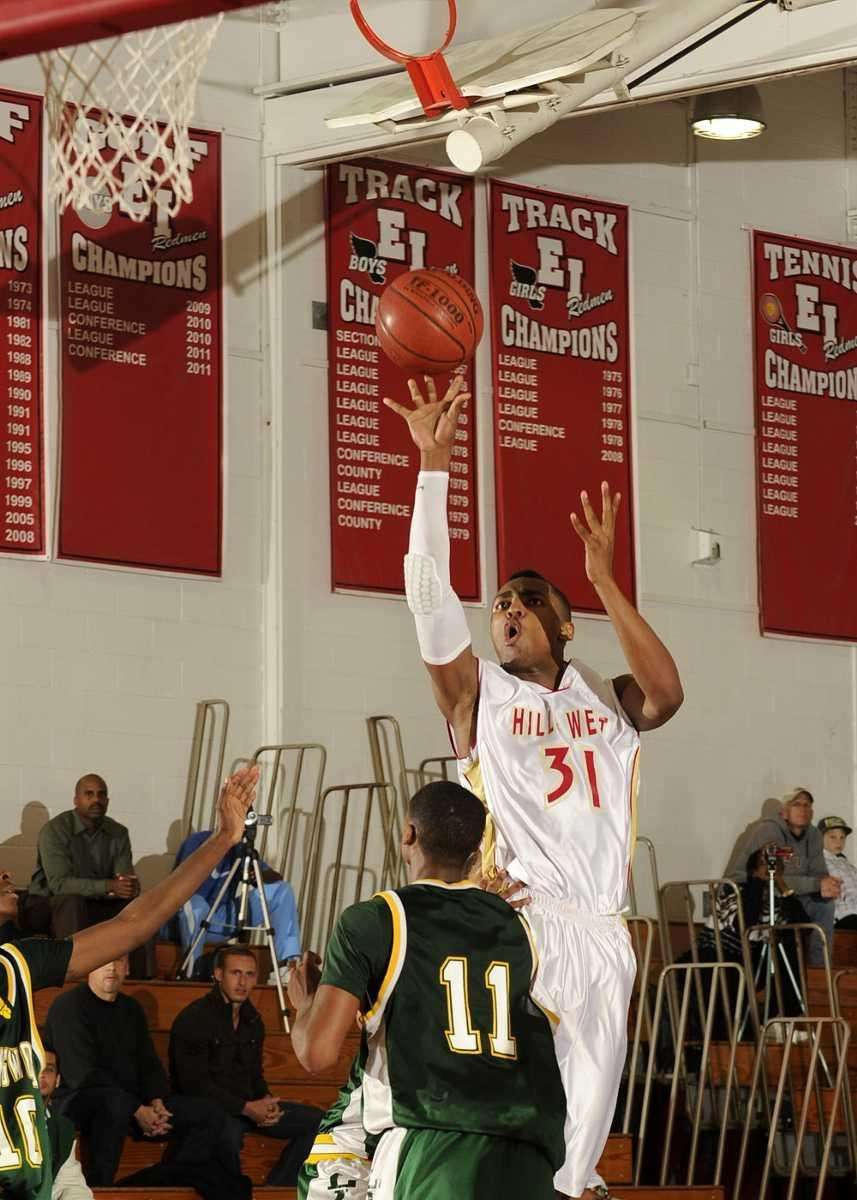 Hills West's Emile Blackman (31) with a 3-point
