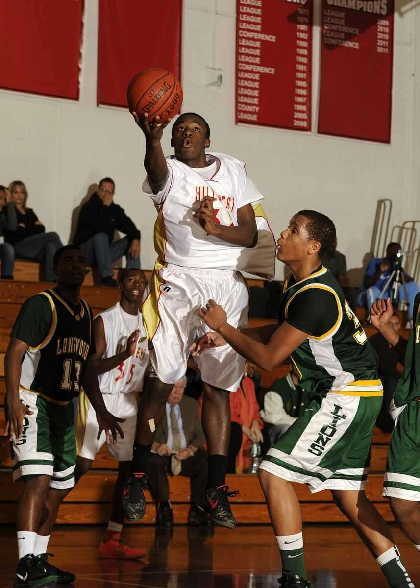 Hills West's Mical Boyd goes up for the