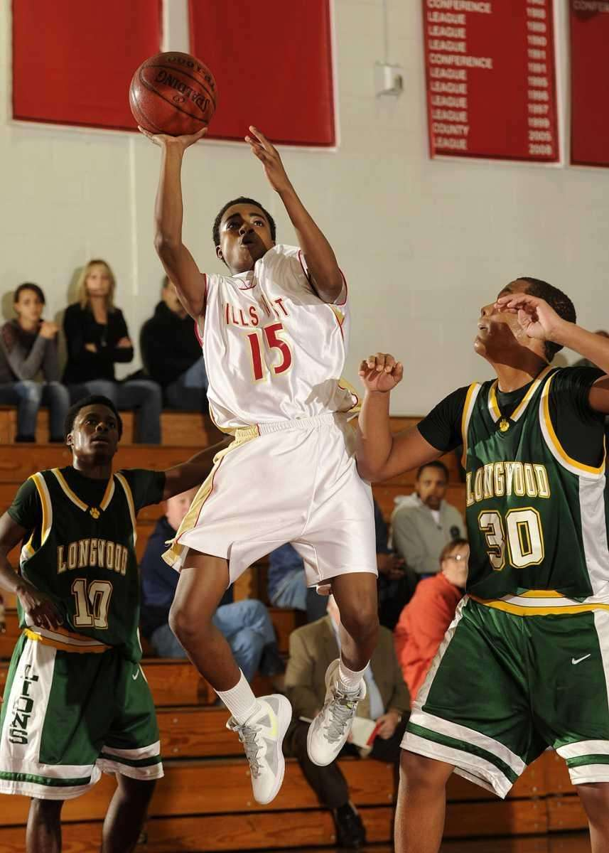 Hills West's Kamal Lewter goes up over Longwood's