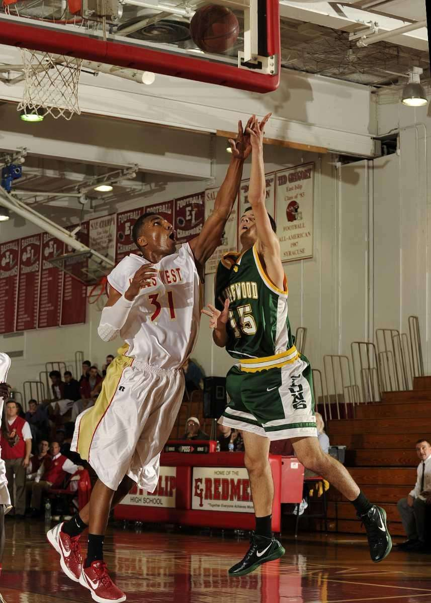 Hills West's Emile Blackman goes up for the