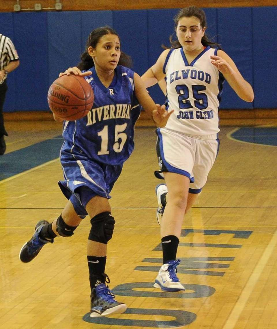 Riverhead's Jalyn Brown drives the ball ahead of