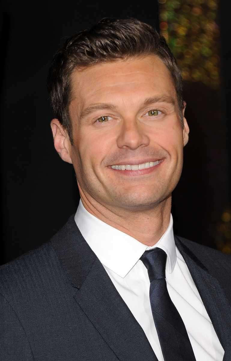 Ryan Seacrest arrives at the premiere of Warner