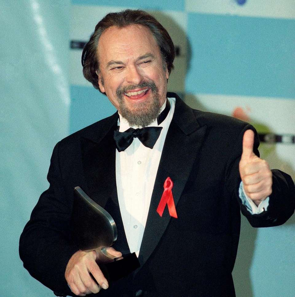 Actor Rip Torn gives a thumbs-up to photographers