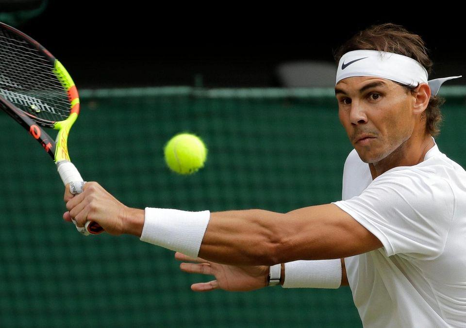 Spain's Rafael Nadal returns the ball to Switzerland's