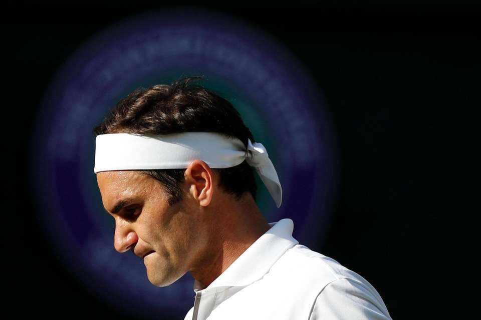 Switzerland's Roger Federer prepares to receive serve from