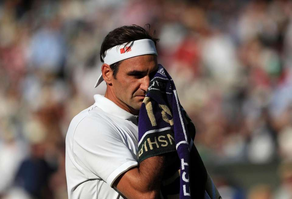 Switzerland's Roger Federer wipes his face as he