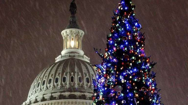Snow falls during the annual lighting of the