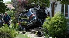 SUV after it hit the second house Friday