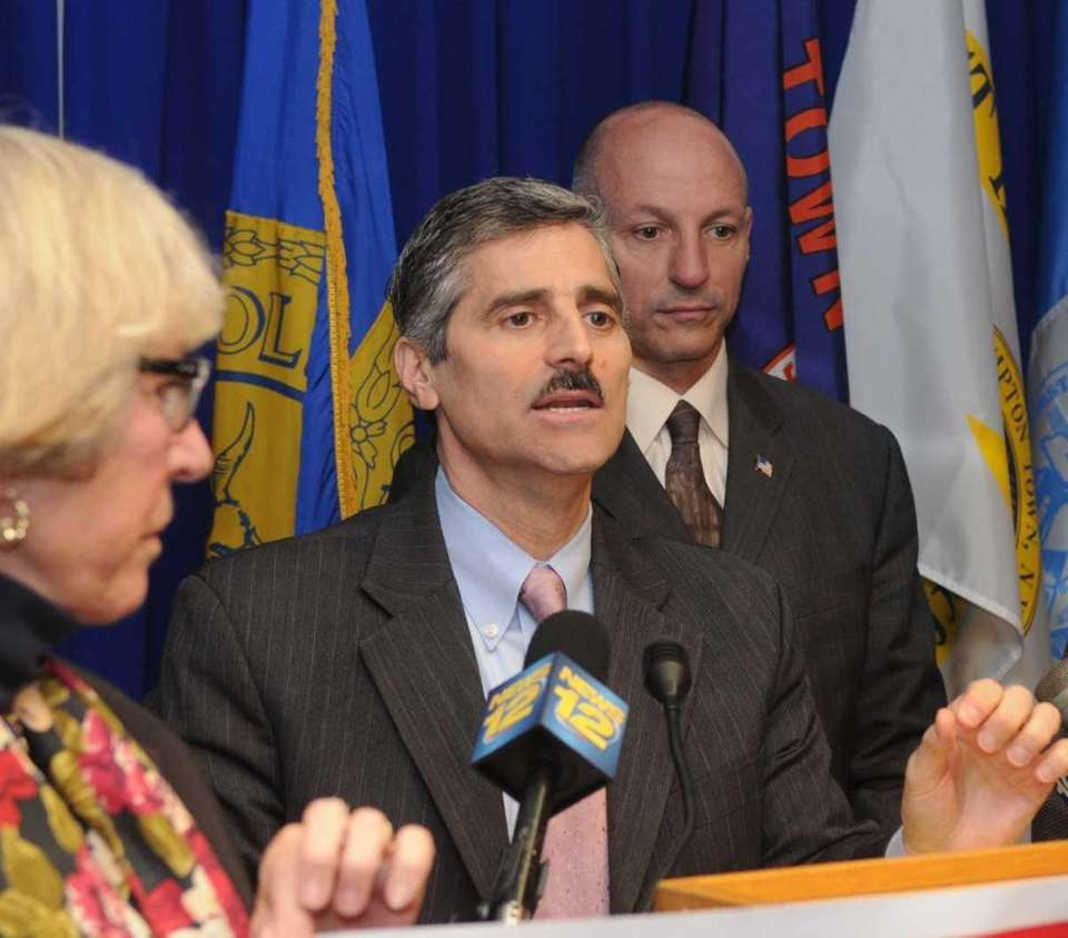 Suffolk County executive Steve Levy holds a news