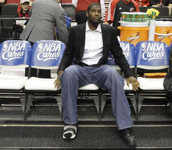 Portland Trail Blazers Greg Oden sits on the