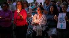 "Huntington residents attend a ""Lights for Liberty: A"