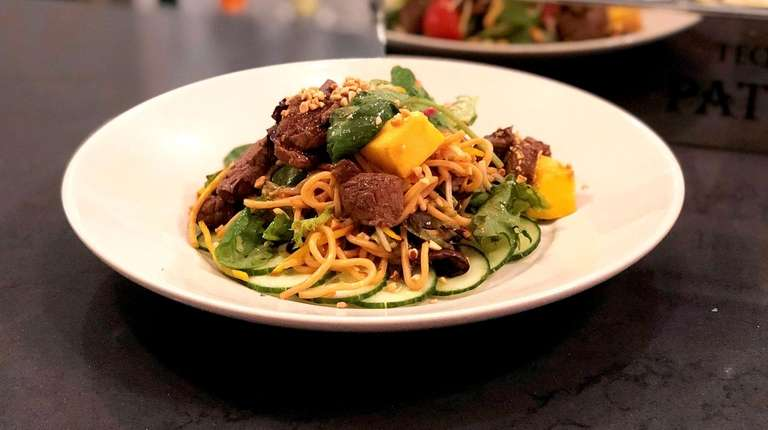 Thai steak and noodle salad is on the