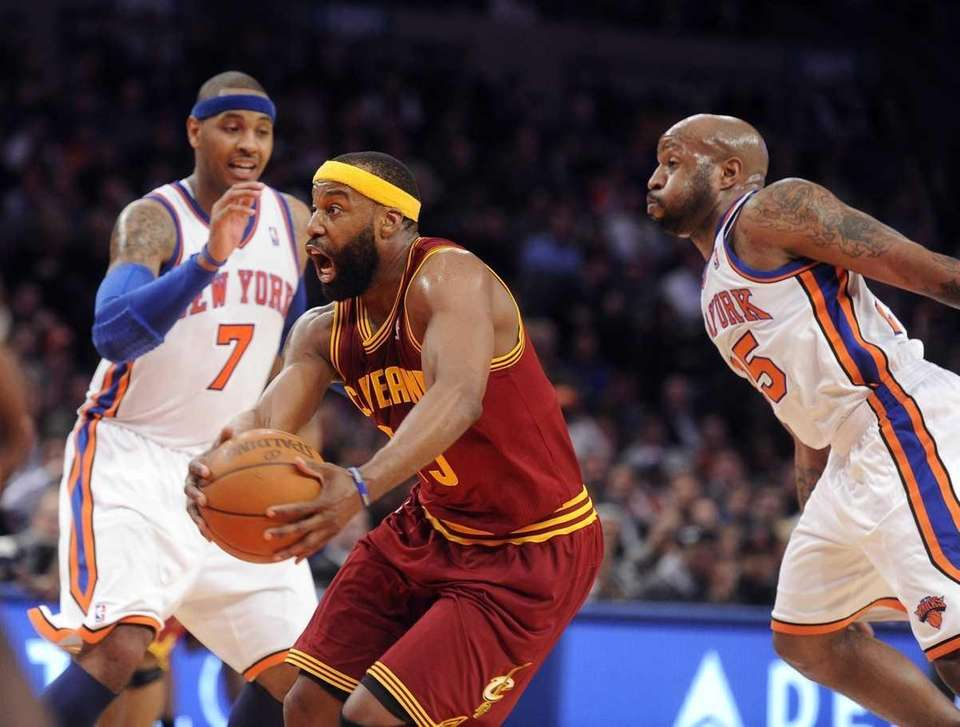 The Cleveland Cavaliers' Baron Davis drives against the