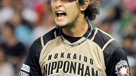 Japanese pitcher Yu Darvish of Nippon-Ham Fighters shouts